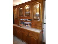 Solid Oak Kitchen for sale. 35 Cabinets with integrated fridge, freezer, dishwasher and microwave