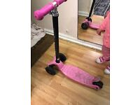 Maxi micro pink and black scooter.
