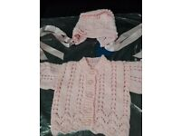 Hand knitted pink cardigan and hat set