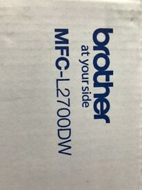 All-in-one compact Mono laser Brand New Brother MFC - L2700DW printer, unopened, unused.
