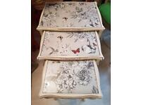 Nest of glass top vintage tables