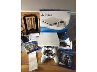 Ps4 500gb only 10 MONTHS OLD with receipt, box, charger, 2x controllers,2 games and a games stand.