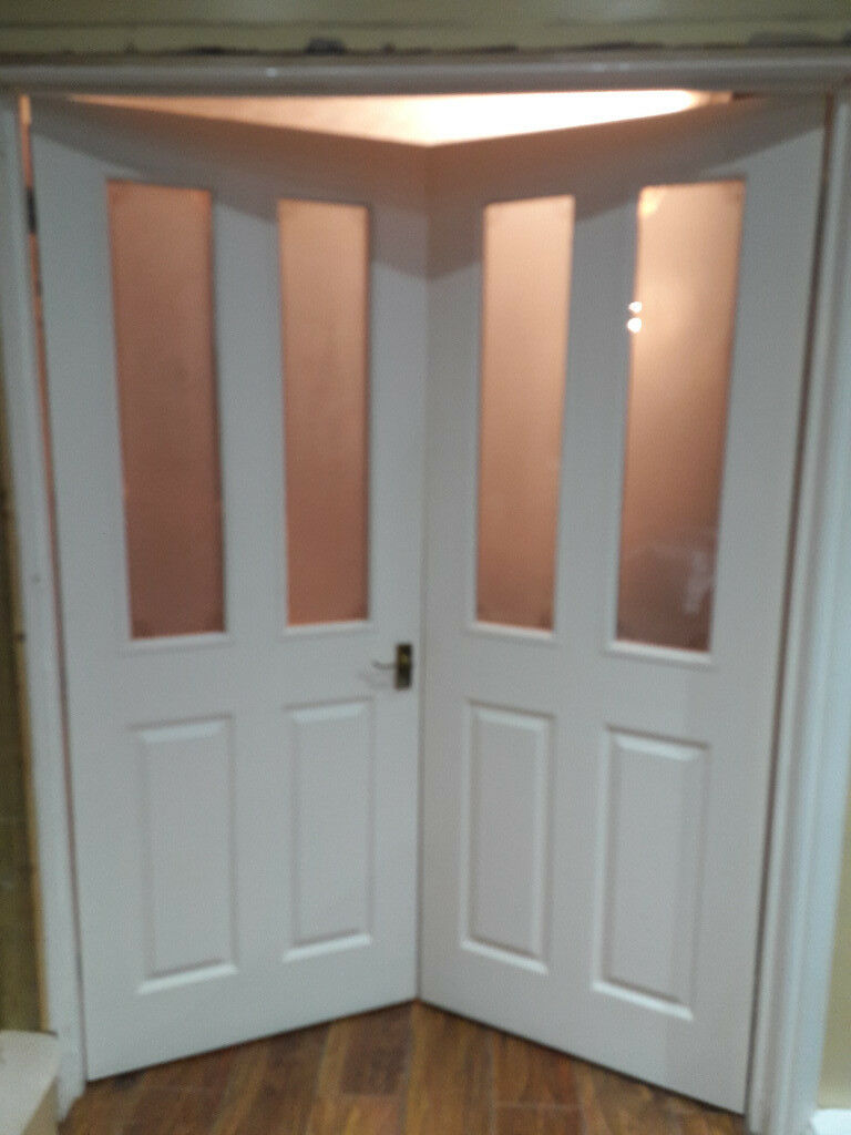 4 Panel Glazed Wood Grain Pair Of Internal Doors In Waterlooville