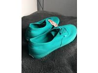 Bright Aqua Vans Authetic, Size 9 never worn. Brand new & comes with the box.