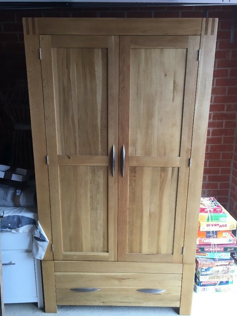 Solid oak wardrobe from Oakland furniture Alto range which is still available. Like new