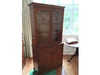 Mahogany veneer china cabinet in 2 parts, with cupboard below and glass doors