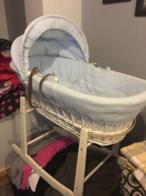 White mosesbasket with blue covers