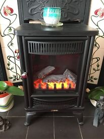 Black electric fire, with blow heater