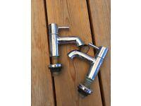 Pair of chrome bathroom basin taps