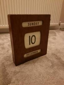 Traditional manual wooden calendar clock