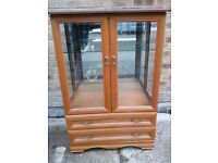 Yew coloured display cabinet