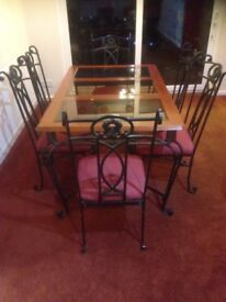 Wrought Iron Glass top table and Six Wrought Iron Chairs, Solid & Heavy