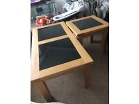 2 solid oak and black glass top tables