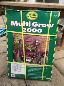 Mini greenhouse for plants and winter protection still in box