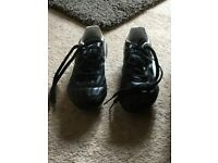 Almost new, Puma studded football boots size 12 childrens.