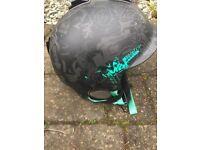 Kids K2 ski helmet with inbuilt headphones.