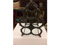 Vintage wrought iron wine rack, with handle that swivels