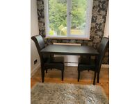 Black dining table and two chairs