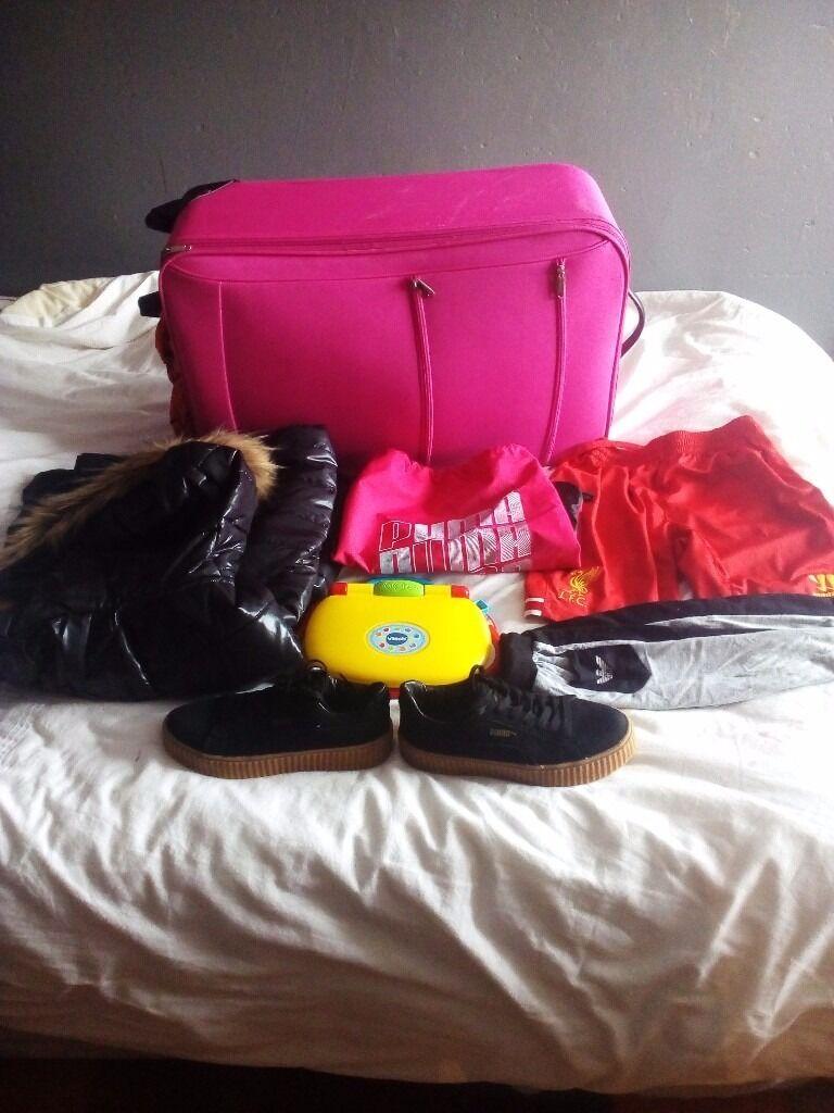 Big bundlein Smithdown Road, MerseysideGumtree - Big sale includes big pink suitcase , women size 8 coat , puma gym bag , boys 12 13 LFC shorts , baby laptop , unisex size 5.5 puma trainers , baby Armani pants 12 18M I can deliver all