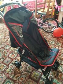 Brand new Hauck pushchair. Black with red rim. For use from birth