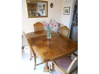 Dining Room suite. Extending table with 6 chairs, and matching cabinet.