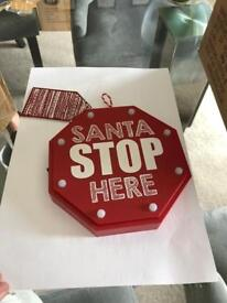 Red Santa stop here sign
