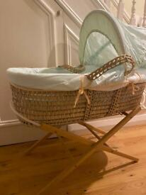 Wicker Moses basket with wooden stand