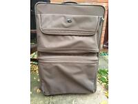 American tourister very large suitcase in brown.