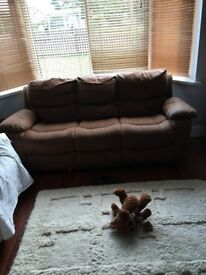 2 brown 3 seater reclining sofas