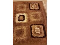 cream and brown rug