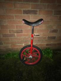 Child's unicycle- cycle king. Christmas party fun