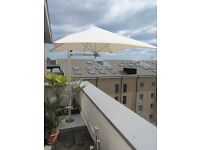 1.9m Paraflex Parasol with extending arm, side post and heavy (200kg) tile base and cover