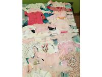 Two bags of baby girl clothes- tiny baby , new born and few 0-3m