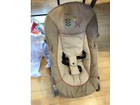 Baby bouncer with activity bar