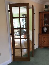 Pair of light brown stained wood glazed internal doors