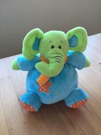 Rattling elephant soft toy