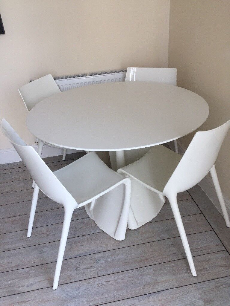 Fantastic DWELL round table and 4 chairs. Saling due to moving house.