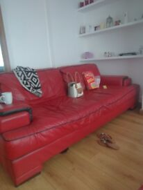 2x 4 seater red leather sofa, in really good condition