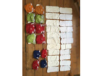 G Nappies Set - x4 small, x8 medium nappies plus loads of pads. The best reusable nappies