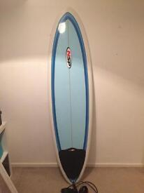 NSP Surfboard with leash and board bag.