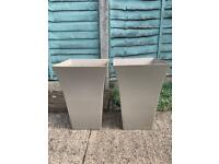 Two tall beige planters