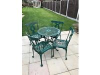 Metal garden table and chairs solid but needs a lick of paint