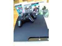 PS3 slim with 2 dualshock controllers and 4 games (Fifa/CoD/...)
