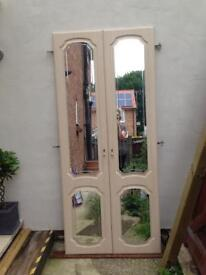 Pair of mirrored wardrobe doors