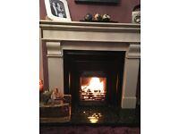 Cream Marble fire surround black cast iron insert and granite hearth black