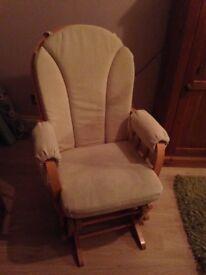 Beige glider chair