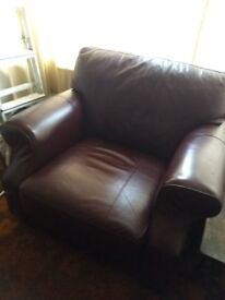 Set of 3 and 2 seater leather sofas, armchair and footstool in dark chestnut.