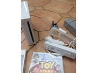 White Nintendo wii with controller and games