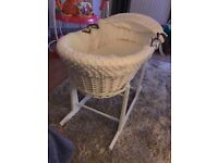 White Moses basket with rocking stand.