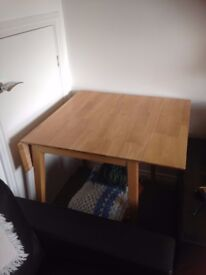 Small dining table and matching chairs. Extends with 2 drop leaves